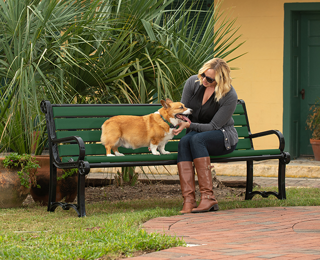 Lifestyle image of owner with dog sitting on the Recycled Pooch Perch Bench Image